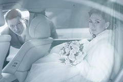 Newly wed couple in car Stock Images