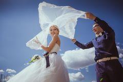 Newly wed couple dancing next to a lake Royalty Free Stock Images