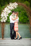 Newly wed couple embracing next to a lake Stock Images