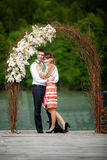 Newly wed couple embracing next to a lake Royalty Free Stock Images