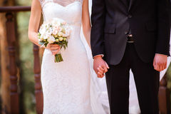 Newly wed couple's hands. Closeup newly weds are holding each other's hand Stock Images