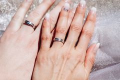 Newly wed couple`s hands with wedding rings.  Stock Images