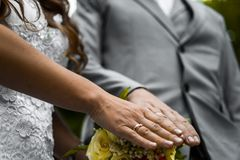 Newly wed couple`s hands with wedding rings.  Royalty Free Stock Images
