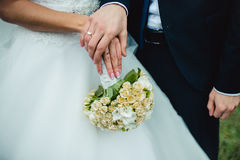 Newly wed couple's hands with wedding rings. Closeup newly weds show their wedding rings Stock Image