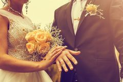 Newly wed couple`s hands with wedding rings. Vintage tone. Newly wed couple`s hands with wedding rings Royalty Free Stock Photo