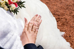 Newly wed couple`s hands with wedding rings. Photo of Newly wed couple`s hands with wedding rings Stock Image