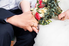 Newly wed couple`s hands with wedding rings. Photo of Newly wed couple`s hands with wedding rings Stock Photos