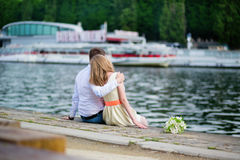 Newly-wed couple sitting on the Seine embankment Stock Image