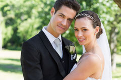 Newly wed couple smiling together in garden Stock Image