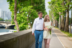Newly-wed couple walking together in Paris Royalty Free Stock Photo