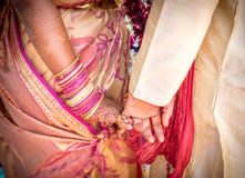 Newly wed Hindu Indian couple holding hands Royalty Free Stock Photo
