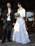 Newly wed welcoming guests. Young couple welcoming guests at their wedding party Royalty Free Stock Image
