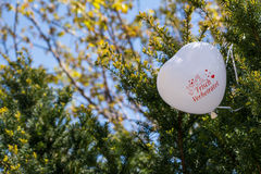 Newly Wed White Heart Balloon Stuck in Green Bush Reception Outdoors Royalty Free Stock Images