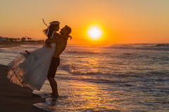 Newly wed young couple on a hazy beach at dusk Royalty Free Stock Photography