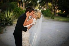 Newly Wedd. A newly wedd couple on a beach stock photos