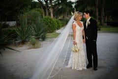 Newly Wedd. A newly wedd couple on a beach stock images