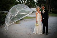 Newly Wedd. A newly wedd couple on a beach royalty free stock photos