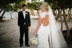 Newly Wedd. A newly wedd couple on a beach stock photo