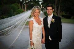 Newly Wedd. A newly wedd couple on a beach royalty free stock photo
