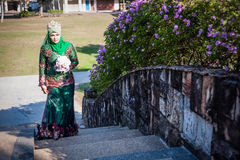 Newly wedded bride posing. Newly wedded Malay bride posing in an outdoor portraiture stock image
