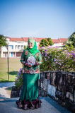 Newly wedded bride posing. Newly wedded Malay bride posing in an outdoor portraiture stock photos