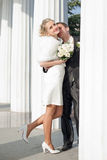 Newly wedded among the columns Stock Image