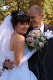 Newly wedded couple. Walking on the park Stock Photos
