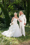 Newly wedded couple in the park Royalty Free Stock Photos