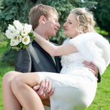 Newly wedded couple in the park Royalty Free Stock Images