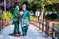 Newly wedded couple posing Stock Images