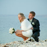 Newly wedded on seashore Stock Images