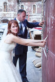 Newly wedding couple trying to open doors Royalty Free Stock Photography