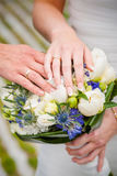 Newly weding couple showing off their wedding rings. Stock Photos