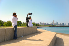 Newly weds. Facing Chicago and having their picture taken royalty free stock image