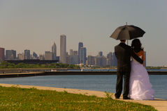 Newly weds. Facing Chicago and having their picture taken royalty free stock images