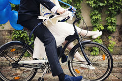 Newly weds on a bike Royalty Free Stock Images