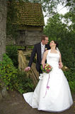 Newly weds in front of an old wooden house Stock Images