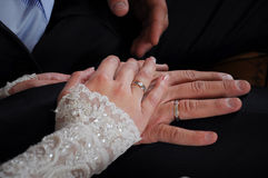 Newly weds holding hands together Stock Photography