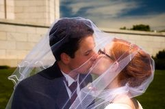 Newly weds kissing Stock Photos