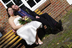 Newly weds making funny faces royalty free stock photography