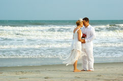 Newly weds near the ocean Stock Photo