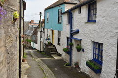 Newlyn village lane. Cornwall, England, UK. Old village street and traditional cottages in Newlyn, fishing town in Cornwall, Britain Royalty Free Stock Image