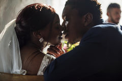 Newlywed African Descent Bride Kissing Groom Wedding Celebration Stock Image