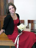 Newlywed with bouquet. Attractive newlywed bride with bouquet of flowers on table in courthouse after wedding Stock Photos