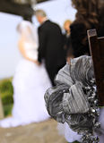 Newlywed couple. Outdoors with focus on decorative ribbon in foreground Stock Images