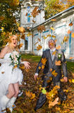 Newlywed couple in autumn park stock photo