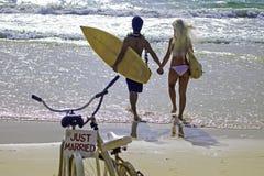 Newlywed couple on the beach Stock Photos