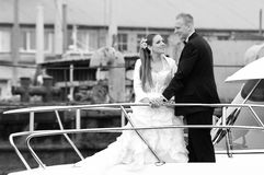 Newlywed couple on boat Royalty Free Stock Photos