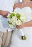 Newlywed couple with bouquet Stock Photography