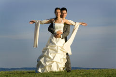 Newlywed couple in countryside Stock Image